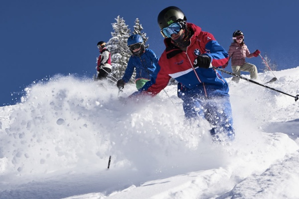 Teenager at the Freeride course with trained instructor of the ski school Alpendorf